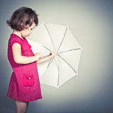 Little girl with  umbrella. Beauty a little girl with umbrella Royalty Free Stock Images