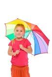 Little girl with umbrella. Studio shot Stock Image