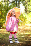 Little girl with umbrella in autumn park Stock Photography