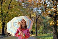 Little girl with umbrella autumn season Stock Photography