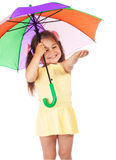 Little girl with umbrella, checking for rain Stock Image
