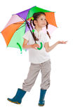 Little girl with umbrella, checking for rain royalty free stock image