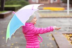 Little girl with umbrella in city royalty free stock images