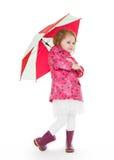 Little girl with umbrella. Stock Photos