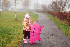 The little girl with an umbrella in the fall Royalty Free Stock Image