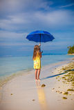 Little girl with an umbrella in hands on her toes Stock Photography