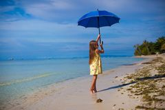 Little girl with an umbrella in hands on her toes Royalty Free Stock Images