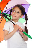 Little girl with umbrella, looking up Royalty Free Stock Images