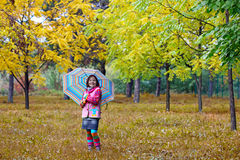 Little girl with umbrella in park autumn season Royalty Free Stock Images