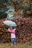 Little girl with umbrella in park autumn season Royalty Free Stock Photography