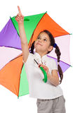 Little girl with umbrella, pointing up Stock Photography