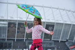 Little girl with an umbrella. In the rain Stock Image