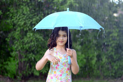 Little girl with umbrella in the rain Royalty Free Stock Photo