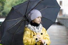 Little girl with an umbrella Royalty Free Stock Photos