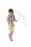 The little girl with an umbrella and in rubber Royalty Free Stock Photo