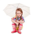 The little girl with an umbrella and in rubber Stock Image