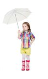 The little girl with an umbrella and in rubber Stock Images