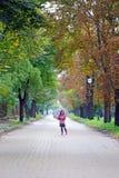 Little girl with umbrella on street Stock Photo