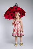 Little girl with umbrella on white Stock Photo