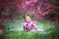 Little girl under blooming crabapple Royalty Free Stock Photography