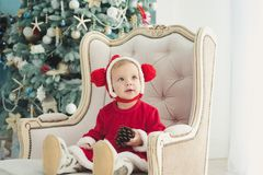 The little girl under the Christmas tree stock images