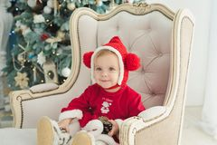 The little girl under the Christmas tree stock image