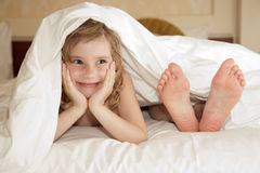 Little girl under cover Royalty Free Stock Images