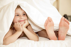 Little girl under cover Royalty Free Stock Image