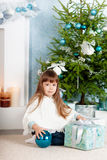 Little girl under the tree on Christmas. A little girl under the tree on Christmas royalty free stock photography