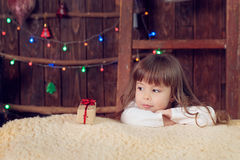 Little girl under the tree on Christmas. A little girl under the tree on Christmas royalty free stock photos