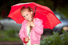 Little girl under an umbrella Stock Photography