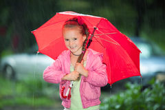 Little girl under an umbrella Royalty Free Stock Photo