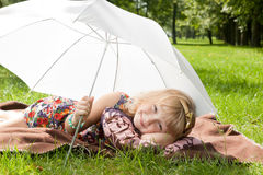 Little girl under umbrella Stock Photo