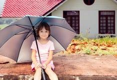 Little girl under umbrella Stock Photography