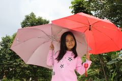 Little Girl under Umbrellas Royalty Free Stock Photo
