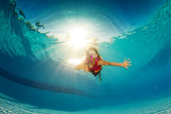 Little girl underwater with flowers Royalty Free Stock Image