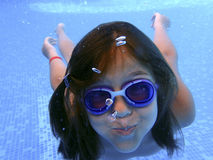 Little girl underwater in the pool Stock Photo