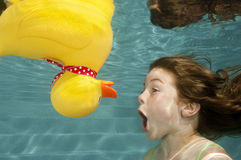 Little Girl Underwater Swimming With Rubber Duck Royalty Free Stock Image