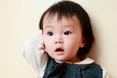 Little girl with unexpected look Stock Photography