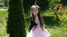 Little girl unicorn with magic dust. Little girl unicorn blows magic pollen stock video