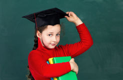 Little girl with university hat Stock Photo