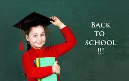 Little girl in university hat Stock Image