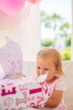 Little Girl Unpacking Her Birthday Gift Stock Photos