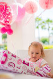 Little Girl Unpacking Her Birthday Gift Royalty Free Stock Photos