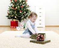 Little girl unpacks the gift Stock Photography