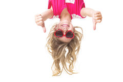Little girl upside down. A Little girl with upside down head stock photos
