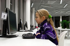 Little girl use computer in a library Royalty Free Stock Images