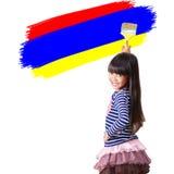 Little girl use paint brush Stock Photos