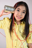 Little girl using a can as telephone Royalty Free Stock Photo