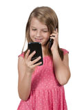 Little Girl Using Cell Phones Stock Image